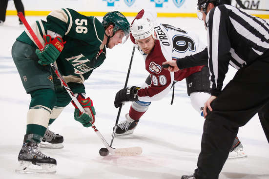 ST. PAUL, MN - APRIL 21: Erik Haula #56 of the Minnesota Wild takes a faceoff against Ryan O'Reilly #90 of the Colorado Avalanche during Game Three of the First Round of the 2014 Stanley Cup Playoffs on April 21, 2014 at the Xcel Energy Center in St. Paul, Minnesota. (Photo by Bruce Kluckhohn/NHLI via Getty Images)
